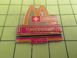 310b Pin's Pins / Beau Et Rare : THEME : McDONALD'S / SUISSE SCHWEIZ WAGON DRAPEAU ALLEMAND FRANKE - McDonald's