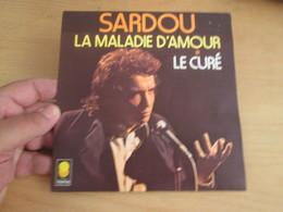 Michel Sardou La Maladie D'amour / Le Curé Label: Trema Format: Vinyle 45 Tours /  6061472 - Compilations