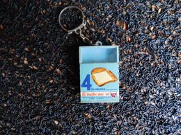 Porte-clefs La Vache Qui Rit, 4 Tranches, Une à L'intérieur  (Box 4-1) - Porte-clefs