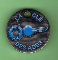 1 Jeton De Caddie *** LA CLE DES AGES *** (0361) - Moneda Carro