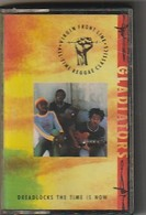 K7 Audio  REGGEA  Gladiators Dreadlocks The Time Is Now  Edit: Virgin Front Line  Etat: TTB Port 90 GR - Cassettes Audio