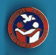 1 PIN'S //  ** GOODWILL GAMES / ATHLÈTE'S VILLAGE ** . (© & TM SOC) - Pin's