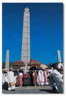 1 AK Äthiopien * Stelen In Axum Und Eine Timkat Prozession Ein äthiopisch-orthodoxe Fest Der Taufe Jesu UNESCO Welterbe - Äthiopien