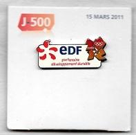 Pin's  Neuf Avec Le Support  Recto  Verso  E D F  J - 500  15  MARS  2011 Partenaire Sports  J.O  LONDON - EDF GDF