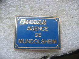Pin's De L'Electricité De Strasbourg, Agence De MUNDOLSHEIM - EDF GDF
