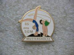 Pin's Des 85 Ans De La Société De Gymnastique De La Commune De MUTTERSHOLZ (Dépt 67) - Gimnasia