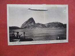The Graf Zeppelin Over The Bay  Rio De Janeiro  Brazil -------Scotch Tape On Top Border   Ref    3554 - Dirigeables