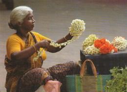 Flower Seller: Rolling Fragrant Jasmine - India