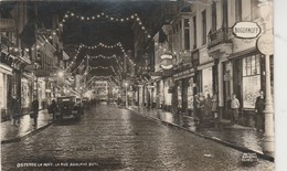 OOSTENDE - OSTENDE - La Nuit , La Rue Adolphe Buyl , ( Photo Antony ) - Familles Royales