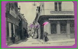CPA (61 Orne) - ARGENTAN  - La Rue De L'Horloge - Très Animé Vue Sur Café De La Paix Quincaillerie Bodier Oblitéré 1915 - Argentan