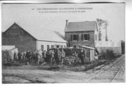 COETQUIDAN  Les Prisonniers Allemands A La Manutention  Ils Font Leur Part De Pain - Autres Communes