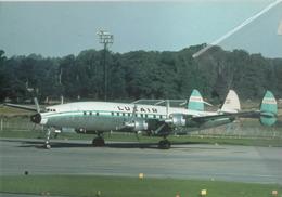 Luxair Lockheed L-1649A LX-LGY  Aviation Airplane Planes Flugzeuge At Gatwick - 1946-....: Era Moderna