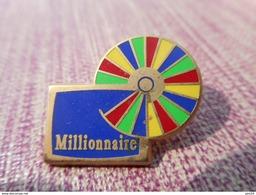 A006 -- Pin's Decat -- Millionnaire - Jeux