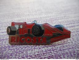 A011 -- Pin's Ricosta -- Exclusif Sur Delcampe - F1