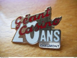 A017 -- Pin's Géant Casino Chaumont 20 Ans - Marques