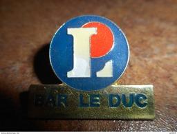 A022 -- Pin's Leclerc Bar Le Duc - Markennamen