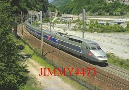 """CPM - Le TGV - R, Rame 4502 """" Alessandro Manzoni """" Paris-Lyon - Milano-Centrale Passe à Orelle-Prémont - Photo R. GIBIAT - Treni"""