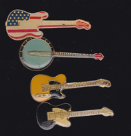 59921-lot De 4  Pin's.-guitare.musique.rock.. - Musique