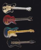 59923-lot De 4  Pin's.-guitare.musique.rock.. - Musique