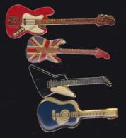 59924-lot De 4  Pin's.-guitare.musique.rock.. - Musique