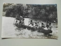ZIMBABWE A NATIVE CANOE ON THE ZAMBEZI RIVER ABOVE THE VICTORIA FALLS - Zimbabwe