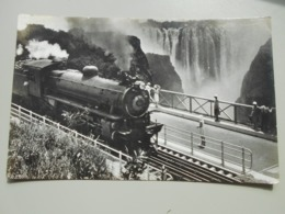 ZIMBABWE A RHODESIA RAILWAYS' TRAIN CROSSING THE VICTORIA FALLS BRIDGE  LOCOMOTIVE - Simbabwe