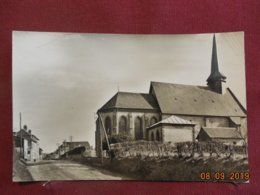 CPSM - Glos - L'arrivée Au Bourg Et L'Eglise - France