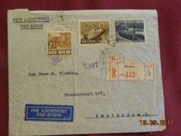 Lettre Des Indes Néerlandaises De 1938 En Recommandé Par La Poste Aerienne Pour Amsterdam - Indie Olandesi