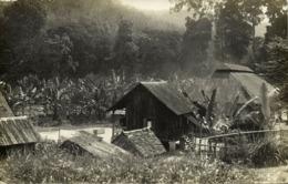 British North Borneo, JESSELTON, Native Houses (1933) RPPC Postcard - Malaysia