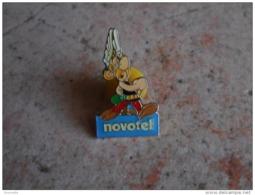 Pin's   :  ASTERIX  - NOVOTEL 1991 - Albert René, Goscinny, Uderzo - BD