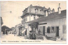 Cpa...Divonne-les-Bains...(ain)...place Des 4 Vents Et Grande Rue...animée...commerces...coiffeur...1912... - Divonne Les Bains