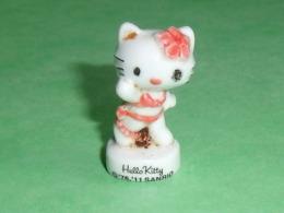 Fèves / Films / BD / Dessins Animés :  Hello Kitty , 2011     T41 - Dessins Animés