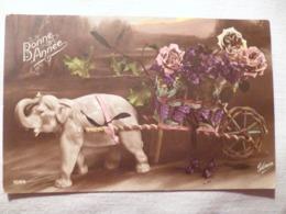 Cpa Fantaisie Elephant En Biscuit Chariot De Fleur Violette Postcard Flower Violet Carte Postale Ancienne Ancien - Éléphants