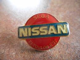 A044 -- Pin's Nissan Sega Toulon Est -- Exclusif Sur Delcampe - Pin's