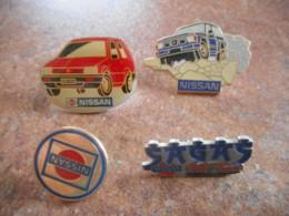 A044 -- 4 Pin's Nissan - Pin's & Anstecknadeln