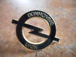 A044 -- Pin's Opel Bonhomme Lyon - Opel