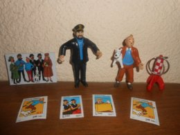 A Saisir Lot Figurines TINTIN Et MILOU 8cm , HADDOCK 9cm , Porte Clef FUSEE 5,5cm, Magnet 7x4.5cm  , 4 Timbres Non Oblit - Tintin