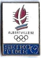 ALBERTVILLE 92 - JO7 - SEIKO TIME - Montre Bleue - Verso : G.L. - Juegos Olímpicos