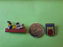 2  PIN'S. 91.RIS-ORANGIS. RUGBY. U.S.R.O. HERALDIQUE. - Villes