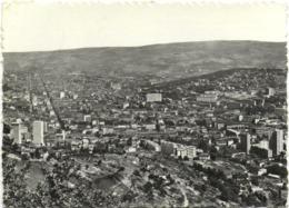 CPSM DE SAINT-ETIENNE  (LOIRE)  VUE GENERALE ET RUE PRINCIPALE - Saint Etienne