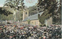 "UK BRADDAN, Ca. 1910, Very Fine Mint Coloured Postcard ""Sunday Service At Braddan"", On The Backside Christmas Wishes - Isle Of Man"