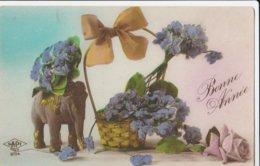 CPA    FANTAISIE  ELEPHANT  FLEURS  BONNE ANNEE VIOLETTES  ECRITE 1925   F5 - Éléphants