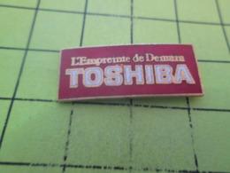 718a Pin's Pins / Beau Et Rare / THEME : INFORMATIQUE / TOSHIBA L'EMPREINTE DE DEMAIN - Informatique
