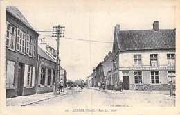 59 - ARNEKE : Rue De Cassel ( Animation - Commerces ) CPA Village (1.650 Habitants)  - Nord - France