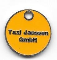 Jeton De Caddie  Jaune  étranger, Transport  Taxi  Janssen  GmbH  Recto  Verso - Trolley Token/Shopping Trolley Chip