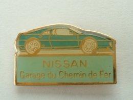 PIN'S NISSAN - GARAGE DU CHEMIN DE FER - Pins