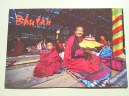 BHOUTAN OM MANI PADME HUM THIS PILGRIM CHANTS A BUDDHIST MANTRA WHILE SPINNING A PRAYER WHEEL... - Butan