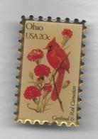 Pin's  Pointe Arrière Recollée, Américain  Forme  Timbre  Ohio  USA 20 C  Avec  Animal  Oiseau  Et  Fleur - Correo