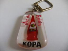 Année 60 1 Porte-clé Bourbon  Plastique  Jus De Raisin  KOPA - Mappe