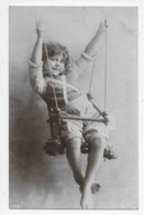 Child In A Swing - Portraits